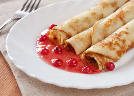 Pancakes with the berry filling. Stock Photo