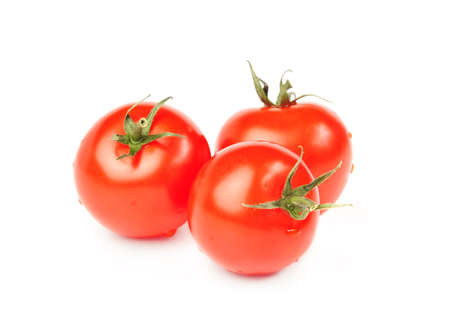 Three red tomatoes on a white background
