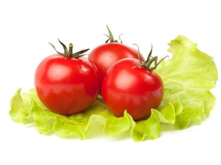 Three red tomato on lettuce leaf  Stock Photo