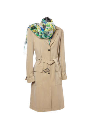 Beige trench coat on a white background.