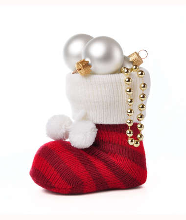 Sock with Christmas toys on a white background.