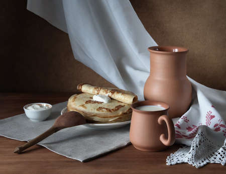 Still Life with pancakes and milk. Stock Photo