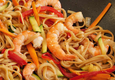 Shrimp with noodles and vegetables. Stock Photo