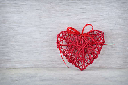 Wooden background with hearts.