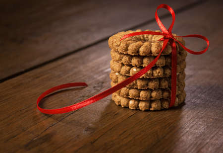 Biscuits with red ribbon on the table.