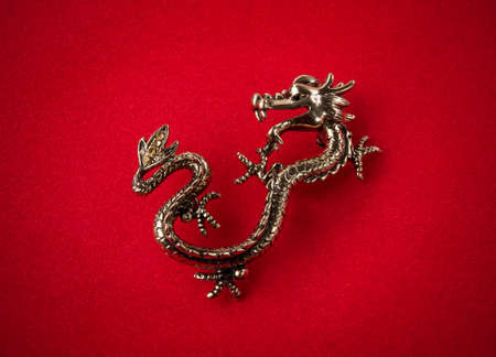 Dragon on a red background.