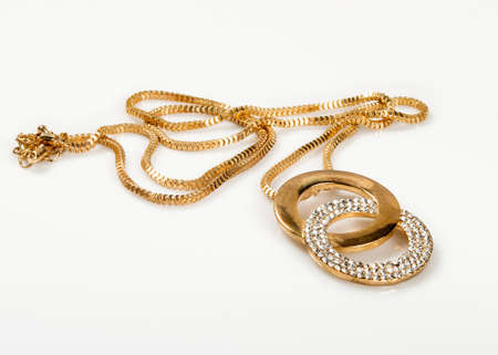 Necklace gold color with rhinestones.