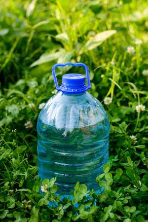 water bottle in a grass  Stock Photo