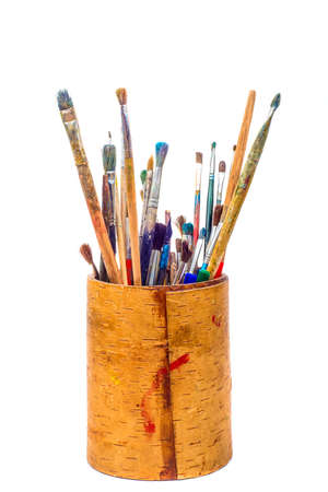 Set of paint brushes in pencil holder isolated on white photo