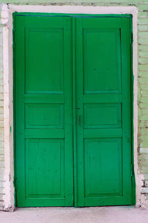 Closed green wooden doors photo