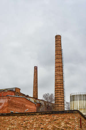 Factory with brick pipes Stock Photo
