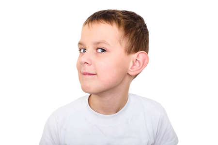 Close up portrait of boy listening with attention isolated on white