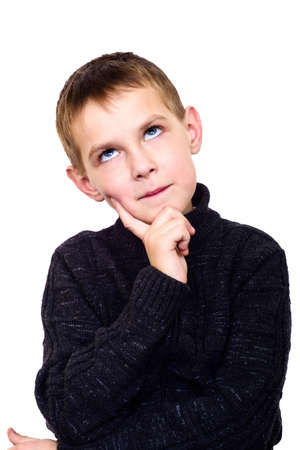 Close up portrait of boy thinking about isolated on white Stock Photo