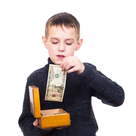 Close up portrait of boy counting money isolated on white photo