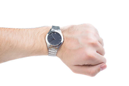 Close-up of mans hand showing time on wristwatch isolated on white