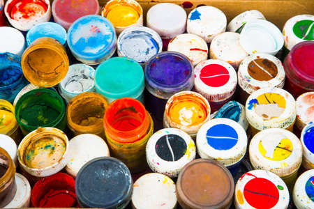 Close up of pile of used cans of gouache paint photo