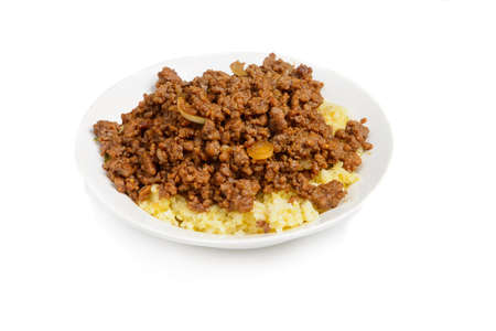 Close-up of dish with fried mince and mashed potatoes isolated on white