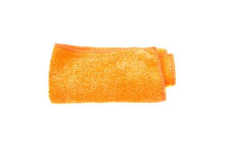 Orange folded cleaning rag isolated on white