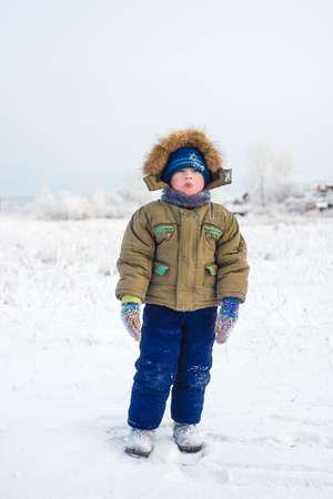 Portrait of little boy in winter time Stock Photo