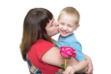 Son giving flowers to his mom on mothers day Stock Photo