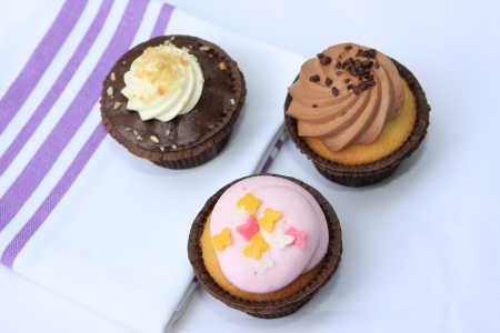 Cupcakes with different toppings Stock Photo - 15630464