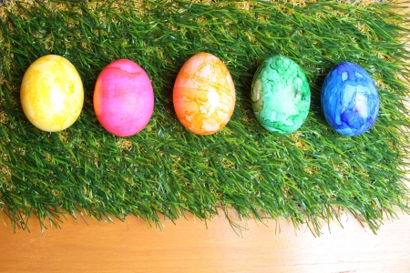 artifical: Colorful Easter eggs on artifical grass