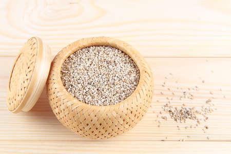 free radicals: sesame seeds on wooden background Stock Photo