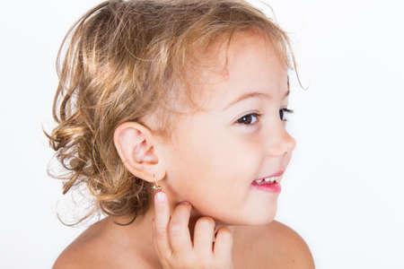 little girl with earring