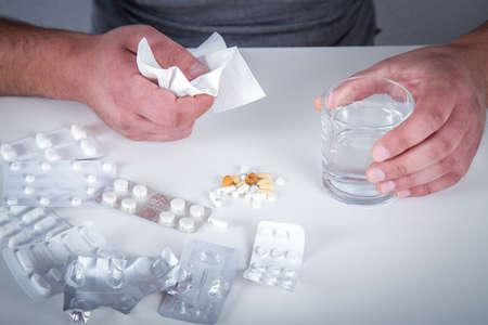 sickly: Sick man taking medicines
