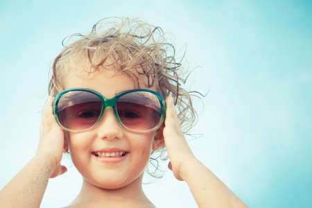 five years': little girl of five years with sunglasses Stock Photo