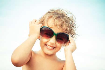 five years': Beautiful little girl of five years with sunglasses Stock Photo