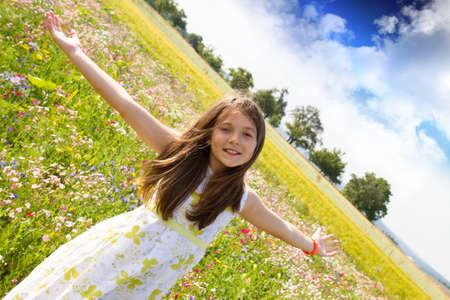happy girl in the field of flowers