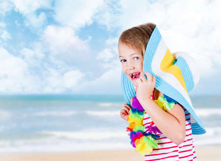five year old: five year old girl in fun beach holiday