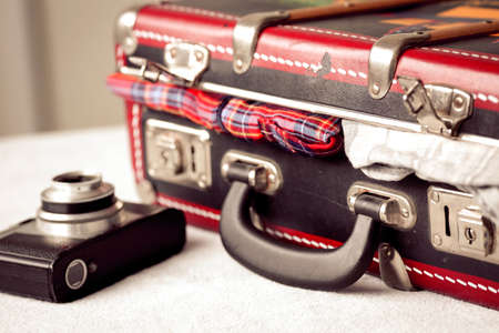 Reflex and suitcase Imagens