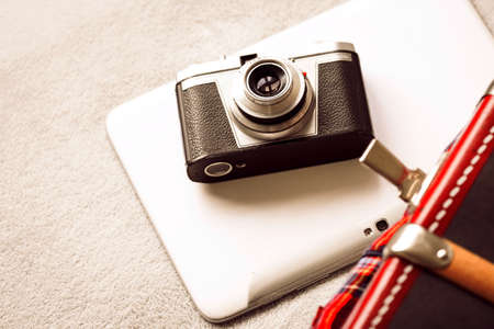 Reflex and notebook with suitcase Imagens