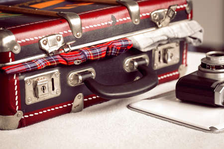 Old suitcase photo camera and laptop