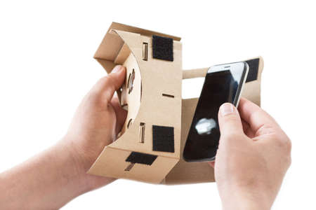 Virtual reality cardboard glasses in the hand