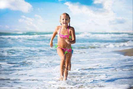 Five years old girl running on the seashore