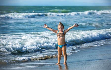 Happy little girl on the seashore