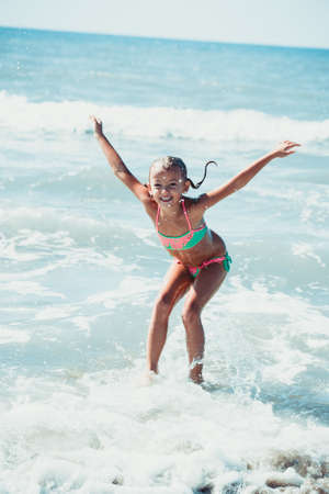 Jumping in sea water. Stock Photo