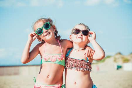 Friends having fun by the sea