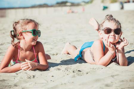 Girlfriends talking on the beach