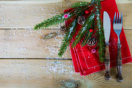 Cutlery for Christmas lunch on wood
