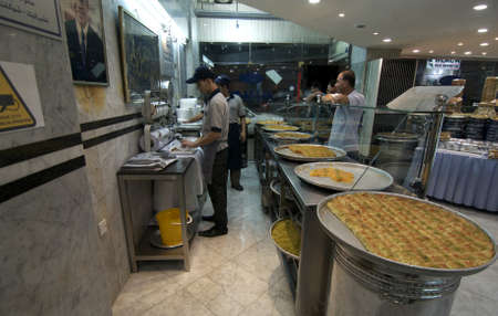 Amman, Jordan, 2011: People selling sweets at a restaurant. Editorial