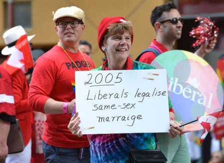 Edmonton, Canada, June-2014: Liberal Woman Holding Pride Sign