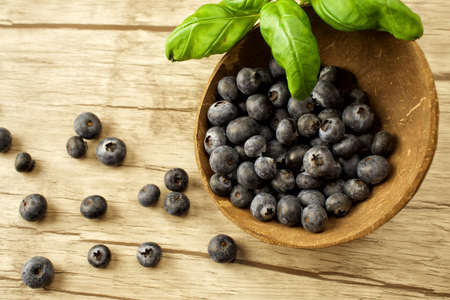 スーパー食品 - 木製の背景の果実 写真素材