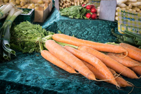 market stall: A bunch of carrots at a market stall