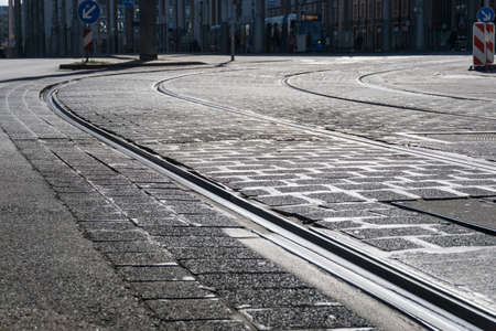 curving lines: streetcar rails with cobbles - ground-up
