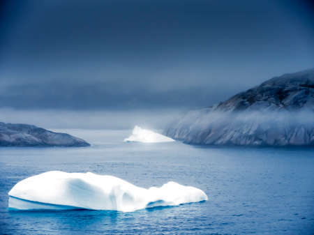 climatic: Small iceberg in Greenland at night Stock Photo
