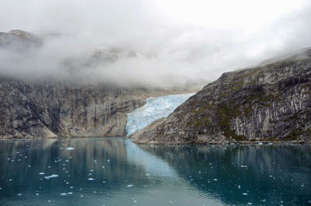 climatic: glacier in the Prince Christian Sound, Greenland, black mood with many clouds Stock Photo